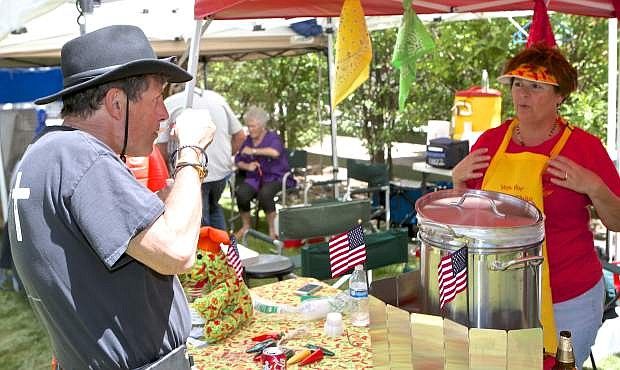 Dr. Gary Santora is served some Wow Wow Chili by Toni Groth Saturday at the International Chili Society's High Sierra Regional Chili Cookoff. The event is a fundraiser for Honor Flight.