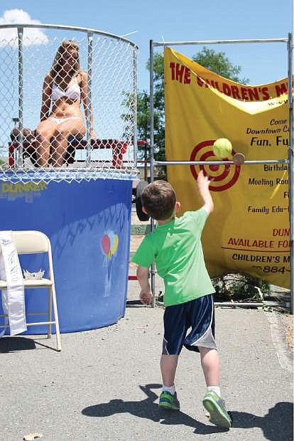 Four-and-a-half year old Luke Rivers of Reno attempts to dunk Miss Nevada 2013 Diana Sweeney, originally of Mound House, at the chili cookoff at Glen Eagles on Saturday.