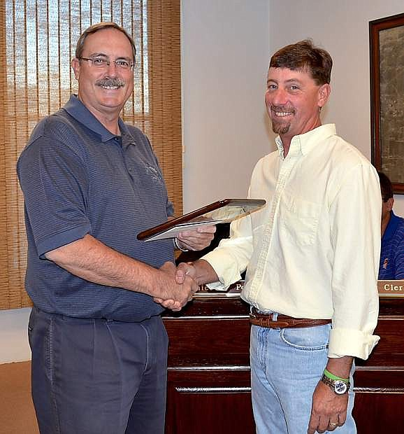 Scott Baker, right, receives congratulations from Mayor Ken Tedford Jr. as the city of Fallon Employee of the Quarter Tuesday.