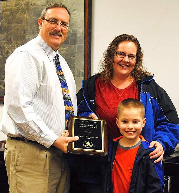 The city of Fallon council recognized Angela Calkins as employee of the quarter. Mayor Ken Tedford Jr., left, presented Calkins with the certificate of appreciation with her son, Brandon by her side.