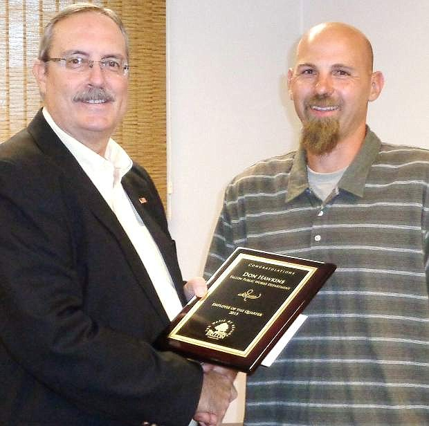 Mayor Ken Tedford, left, recognized Don Hawkings as Employee of the Quarter at the city councils recent meeting.