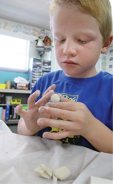 Fritsch Elementary School second-grader Eric Billings works on a clay art project.