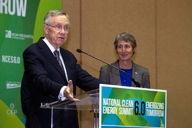 Senate Majority Leader Harry Reid, D-NV,  responds to a question about the stalled Yucca Mountain nuclear waste storage facility during a news conference at the National Clean Energy Summit 6.0 at the Mandalay Bay Resort in Las Vegas Tuesday, Aug. 13, 2013. Interior Secretary Sally Jewell listens at right. (AP Photo/Las Vegas Sun/Steve Marcus)
