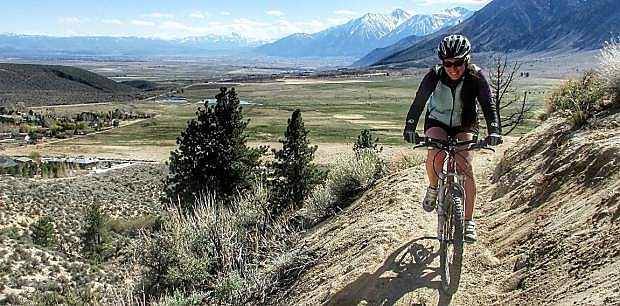 Kristy Moser rides the newly constructed Clear Creek Trail. A grand opening for the trail will be April 12 and 13.