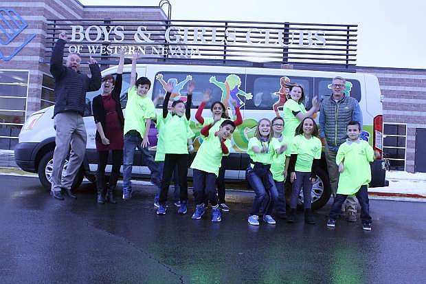 Tim Milligan, general manager of Campagni Auto Group, Katie Leao and Kurt Meyer, chief professional officer and president of the board of the Boys & Girls Clubs of Western Nevada, celebrate the purchase of two new vans, courtesy of a grant from the E.L. Wiegand Foundation.