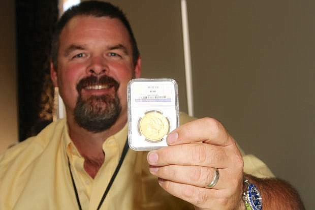 Allen Rowe of Northern Nevada Coin shows a 70cc $20 gold coin valued at $268,500 on Friday at the Carson Nugget.
