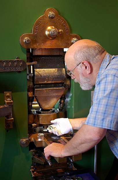 Volunteer Ken Hopple will operate the historic Coin Press No. 1 from the U.S. Mint at the Nevada State Museum's National Coin Week celebration April 25-26.