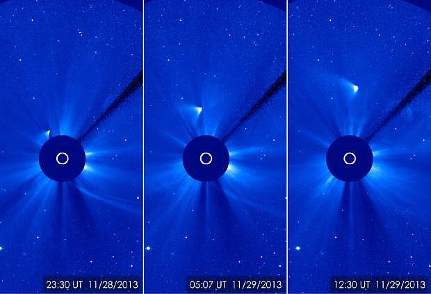 In this combination of three images provided by NASA, comet ISON appears as a white smear heading up and away from the sun on Thursday and Friday, Nov. 28-29, 2013.  ISON was not visible during its closest approach to the sun, so many scientists thought it had disintegrated, but images like this one from the ESA/NASA Solar and Heliospheric Observatory suggest that a small nucleus may still be intact. (AP Photo/NASA)