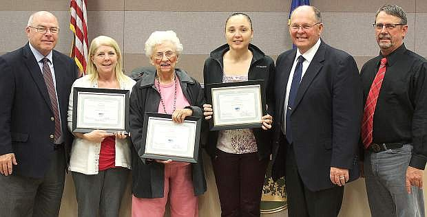 The Churchill County Commissioners recognized volunteers that participated in the Volunteer Income Tax Program. From left are commissioner Bus Scharmann, Holly Padilla, Lois James, Jennie Cos and commissioners Pete Olsen and Carl Erquiaga.