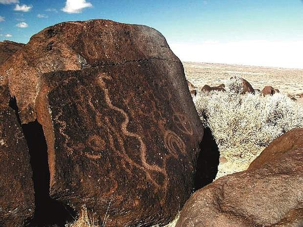 A petroglyph rock faces the trail at Grimes Point.