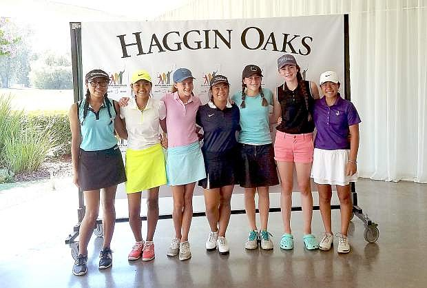 Karen Beglin, pink golf shirt, won first place at the Drive Chip & Putt Sub-Regional qualifier recently in Sacramento.