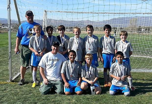 The Carson Futbol Shock U11 boys soccer team finished second at the Comstock Shootout last weekend. Front row, left to right, coach Dwight Millard, Kristian Chicas, Jack Kalicki, Jose Godines. Back row, left to right, coach Kyle Walt, Kaden Walt, Adrian Lopez-Meraz, John Miles, Paul Wagner, Roberto Cazares, Joe Antonio Torres, Kaden Millard. Missing from the photo is Anthony Ramirez.