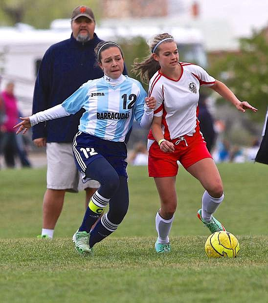 CV United's Sedona Robinson pushes the ball upfield as Pacifica's Sydney Burnham defends Saturday at the Comstock Shootout.