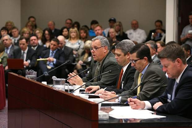 Construction industry representatives testify before a joint judiciary committee at the Legislative Building in Carson City, Nev., Wednesday, Feb. 11, 2015. The hearing drew large crowds as lawmakers work to curb frivolous construction defect lawsuits. (AP Photo/Cathleen Allison)