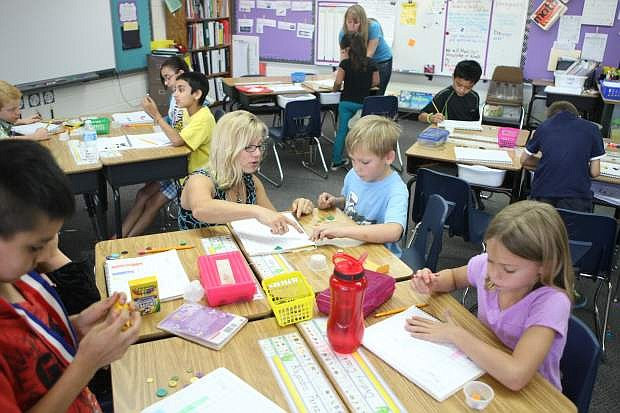 Bonnie Benson's second-grade class at Fritsch Elementary School learn about graphing on Friday.