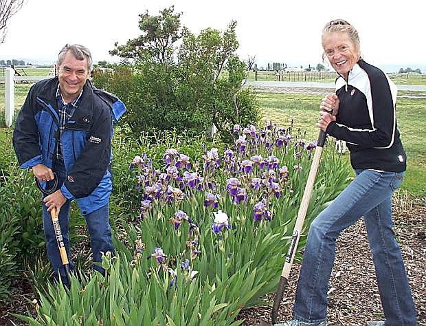 Mark Jensen, curator of the Dangberg Home Ranch Historic Park, and Suzy Stockdale, chairman of the Smallwood Foundation, work in Gertrude's Garden at the park earlier this year.