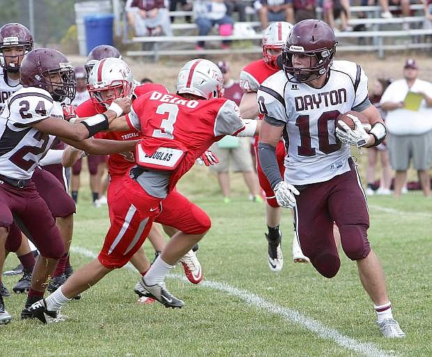Dayton's Austin Fletcher runs to the outside against Truckee earlier this year.