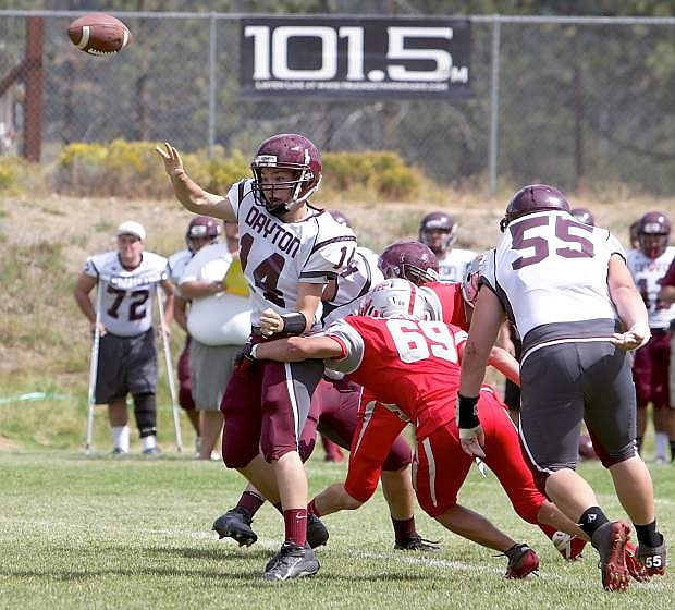 Dayton's Davis Winebarger makes a pass as the Truckee defense closes in during Saturday's game.
