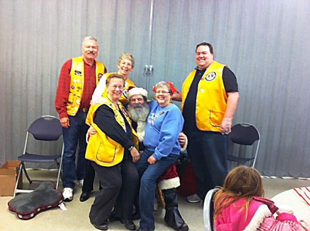 Last Saturday the Dayton Valley Lions and Silver Springs Lions, together with the Sullivan family, sponsored a Santa visit at the Silver Springs Community Center, where about 130 children saw Santa, received a stuffed animal and enjoyed hot chocolate and cookies. Pictured are some of the sponsors with Santa.
