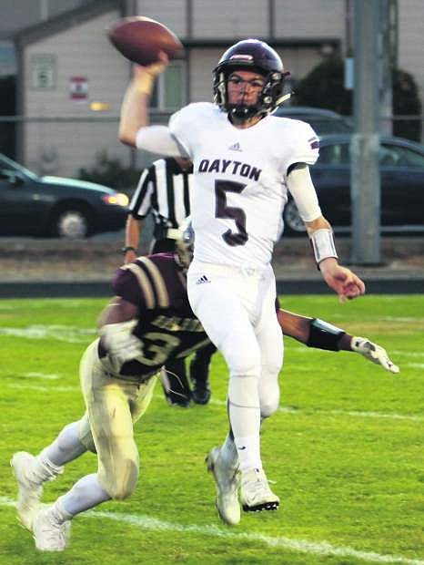Dylan Torgerson of Dayton gets rid of the ball against Sparks on Friday.