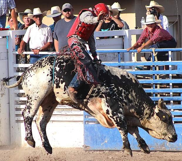 Fallon's Billy Quillan rides a bull during the De Golyer Buckin' Horse and Bull Bash 2015. Quillan won the bullriding event.