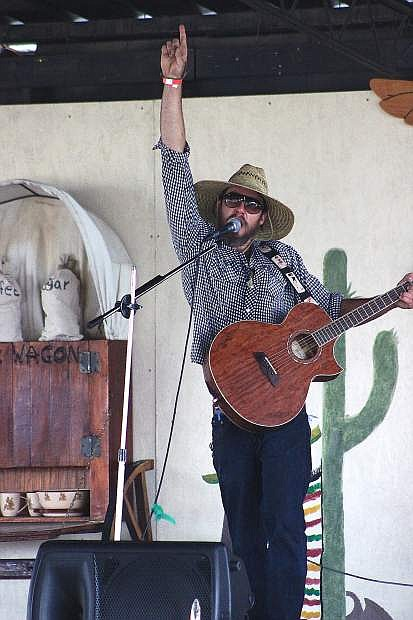 Steven Christie performs during the second annual De Golyer Buckin' Horse and Bull Bash on Saturday at the fairgrounds.