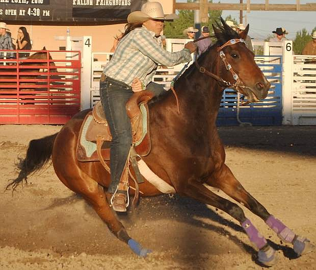 Kelly Quillan picks up speed in the barrel races, one of the most popular attractions of  the third annual DeGolyer Buckin' Horse and Bull Bash.
