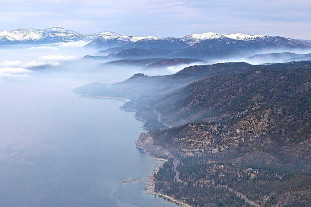 Cave Rock, the east shore, and a controlled burn is seen from high above Lake Tahoe on Wendesday during a scenic tour courtesy of Pilot Moe Makowski and Carson Aviation Services.For more photos, see page A5.