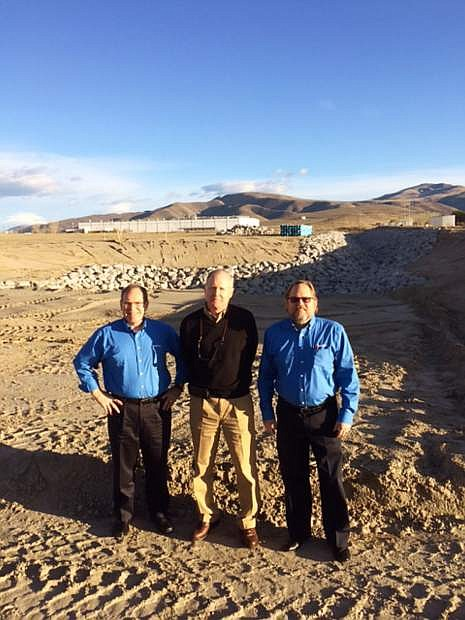 Standing at the sight of the new Deceuninck North America (DNA) plant in Fernley, are James Keller, legal counsel DNA; Richard  Ahner, systems analyst DNA; and Scott Gunnell, senior supply chain manager DNA and project manager for the Fernley plant construction.