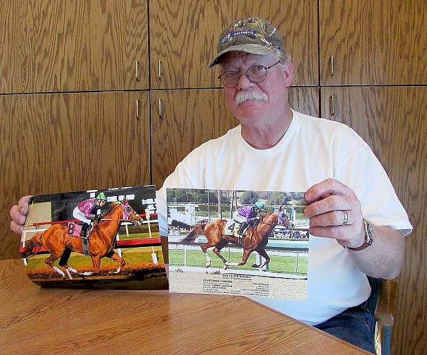 Steve Coburn displays photos of California Chrome, the early favorite to win at the Kentucky Derby on May 3.