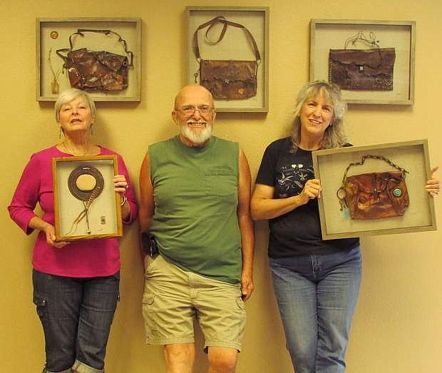 Donna Nelson, left, an artist from Smith Valley, is seen with John Smith, president of the Friends of the Dayton Valley Library, and artist Pamela Nesbit of Smith Valley.