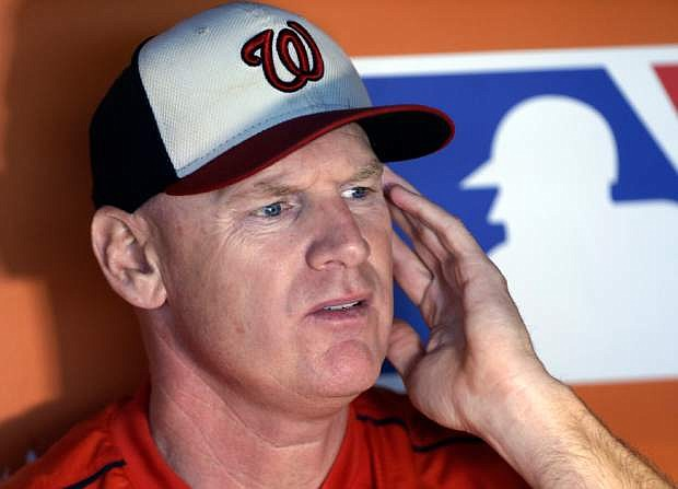 FILE - This Sept. 12, 2015, file photo shows then-Washington Nationals manager Matt Williams responding to a question as he is interviewed in the dugout before a baseball game against the Miami Marlins, in Miami.  (AP Photo/Lynne Sladky, File)