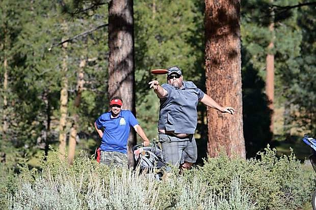 A disc golfer competes in a past King of the Lake tournament. The tournament, which draws an elite field of professionals, will take place today through Sunday at five different courses between Truckee and South Lake Tahoe.