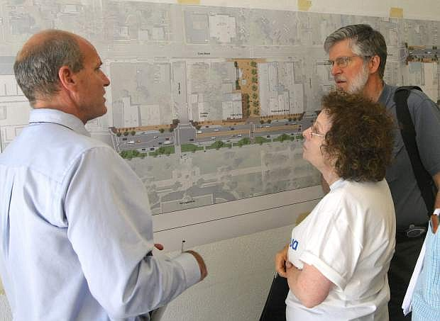 Steve Noll, left, of Design Workshop talks with Carson City residents David and Elinor Bugli about the downtown improvement plan on Monday.