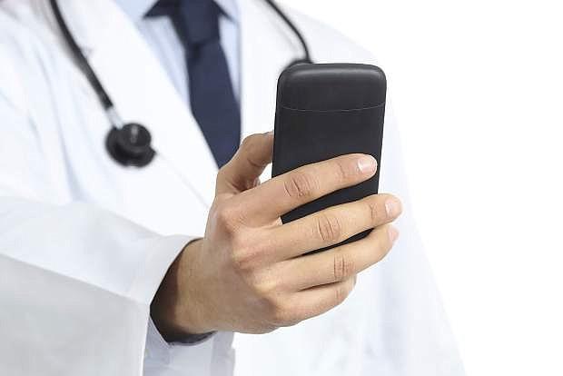 Doctor man hand using smart phone