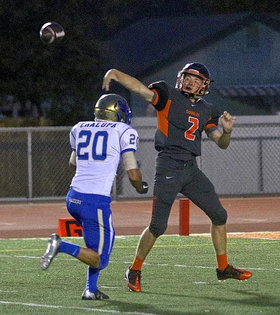 Douglas quarterback dumps off a pass under pressure in a loss to Reed 67-20 Friday night at Keith Roman Field.