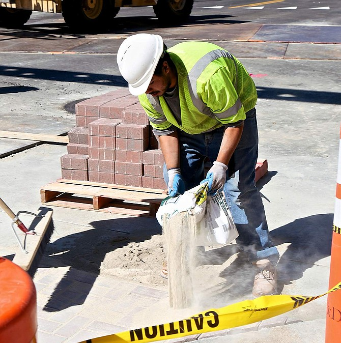 Work continues on Carson Street on Friday. The city has set an Oct. 28 date for a ribbon cutting.