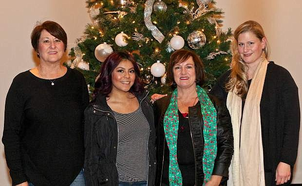 Susan Sorenson, Director of the Northern Nevada Dream Center, Carson High senior Shaelyn Sanchez, Gere Clark of James Gaskets and Erin Van Sickle of Catering for Causes pose for a photo at Capital Christian Center in south Carson City Friday afternoon.