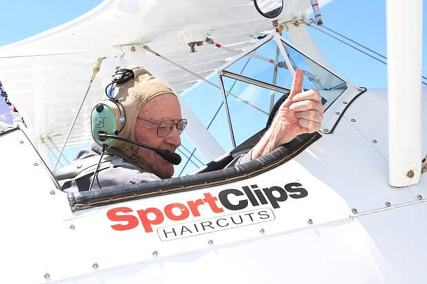92-year-old George Everest gives a thumbs up prior to takeoff in a 1942 Boeing Stearman bi-plane Friday morning at the Carson City Airport.