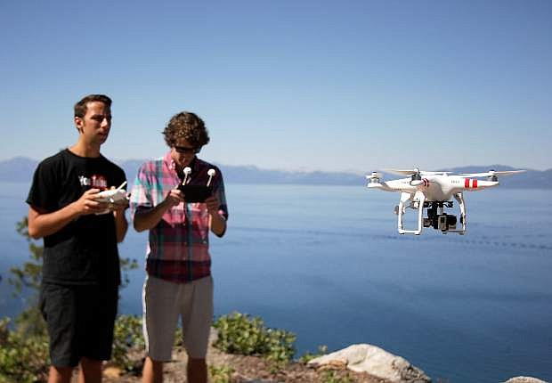Lloyd Garden, left, and Brad Flora, owners of Incline Village-based Drone Promotions, fly their drone off the North Shore of Lake Tahoe on July 12. Garden serves as the pilot, while Flora watches the feed being captured by the unmanned aircraft.