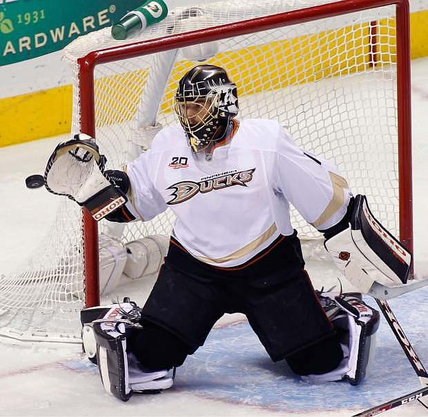 Anaheim Ducks goalie Jonas Hiller catches the puck during the second period of an NHL hockey game against the San Jose Sharks, Saturday, Nov. 30, 2013, in San Jose, Calif. (AP Photo/George Nikitin)