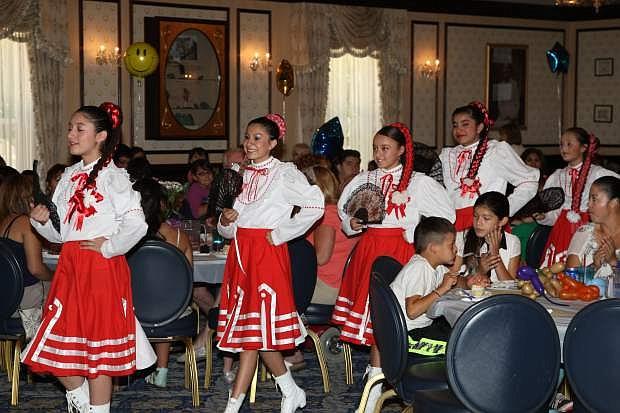 The Metzonali Dancers, Ashley Guadarrama, 10, Esmeralda Salcedo, Natalie Villafana, Nitza Velazquez, all 12 and Citlaly Munoz, 14, prepare to perform for the crowd at the ESL 10th Award Appreciation Ceremony at the Governor's Mansion Saturday.