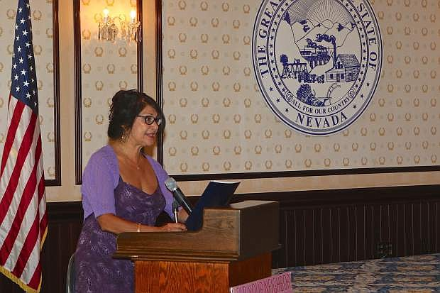 Yolanda Garcia from Senator Harry Reid's office speaks to the crowd Saturday at the ESL 11th Award Appreciation Ceremony at the Governor's Mansion.
