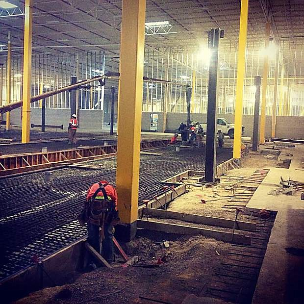 Construction workers prepare a building for a concrete pour at the Tahoe Reno Industrial Center. Numerous construction projects are underway at TRIC, including multi-year projects for Tesla, Switch, and eBay.