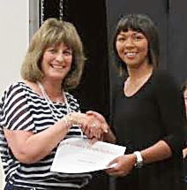 Fernley Republican Women President Carol Franich presents a scholarship to Kailanee Young Reyes of Fernley High School.