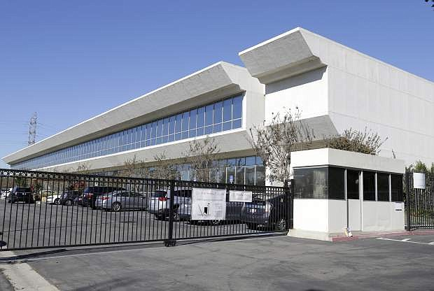 FILE - This Nov. 6, 2015, file photo shows the Faraday Future building in Gardena, Calif. Chinese-backed electric carmaker Faraday Future plans to build a $1 billion manufacturing plant in North Las Vegas, according to a letter the company sent Nevada officials Wednesday, Dec. 9, 2015. The upstart, California-based automaker chose Nevada over three other states after extensive negotiations with Nevada's economic development team. Its tentative agreement to build the factory is contingent upon the state authorizing major tax incentives. (AP Photo/Nick Ut, File)