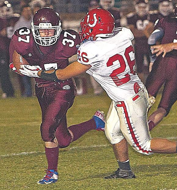 Elko's Jayson Wilson attempts to break a tackle in a game last year.