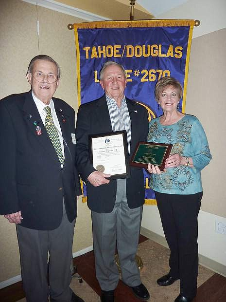 Exalted Ruler Russ Wailes presents Tom Zogorski with the Citizen of the Year award. Tom's wife, Katherine, is at right.