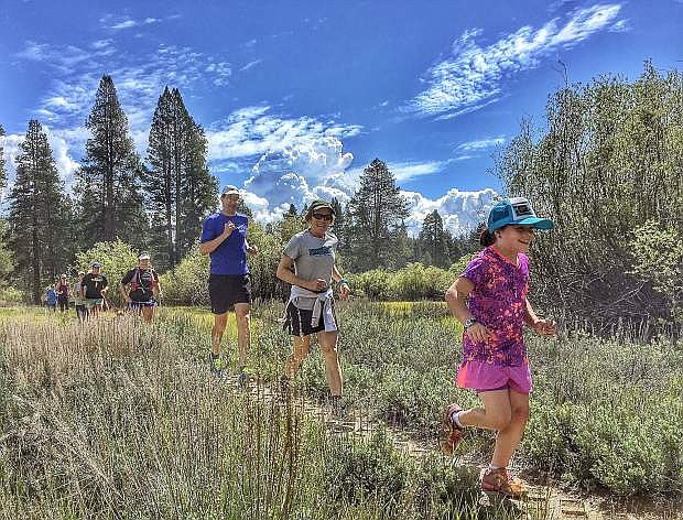Members of the Donner Party Mountain Runners club go on a group run in Truckee during a previous summer.