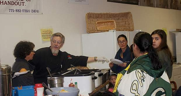 Volunteers help serve food at the Carson City FISH for their grand re-opening Thursday night.